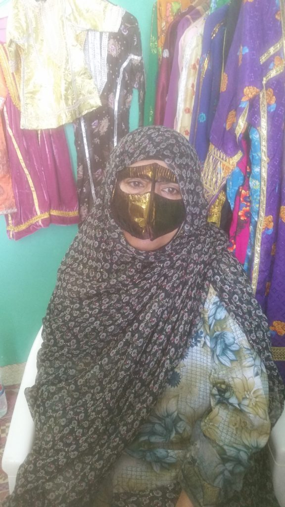 Shopkeeper- one of the women in the project, in traditional Bandari burqa.