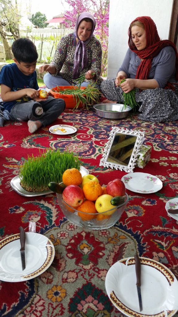 Relatives preparing food on the verandah & fruit offered to us...very typical for guests to be given fruit, a knife and a plate in Iran.