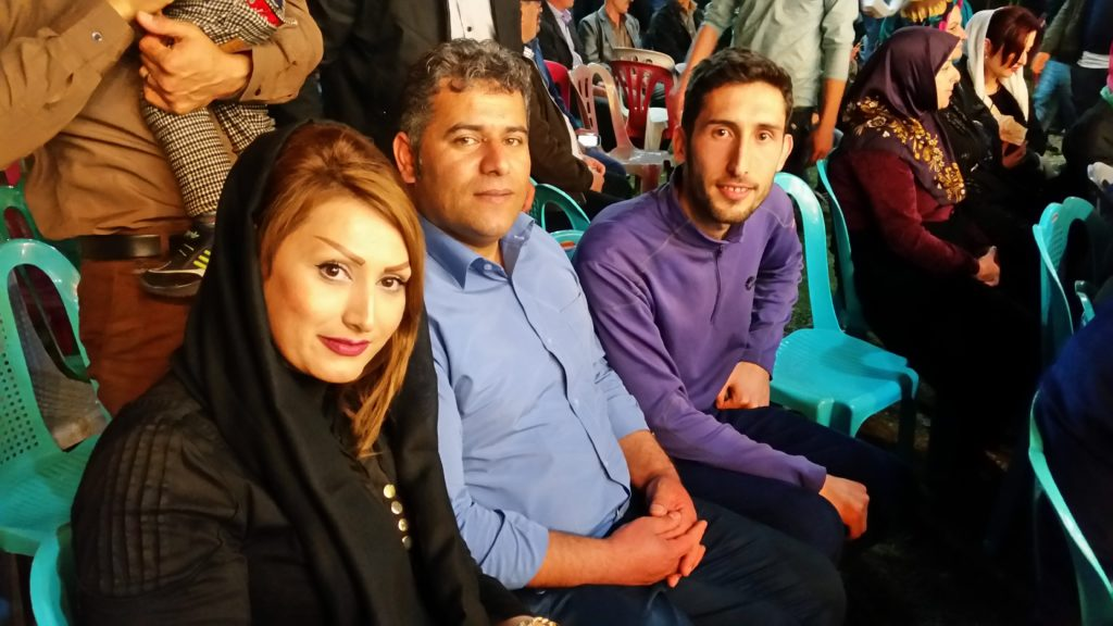 Hamed with his sister and brother in law at the wedding party.