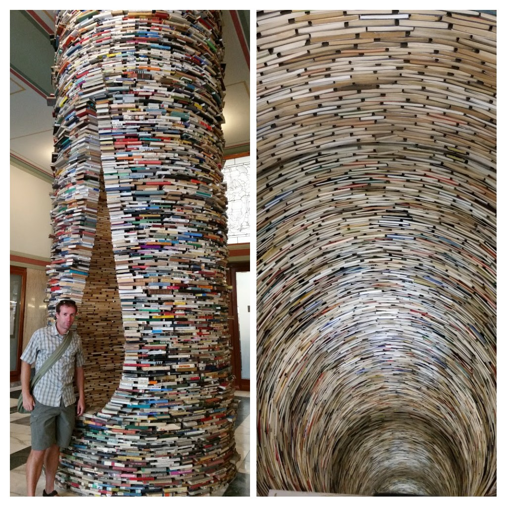 Tower of books (L) from the outside and (R) looking down inside it. Prague Library