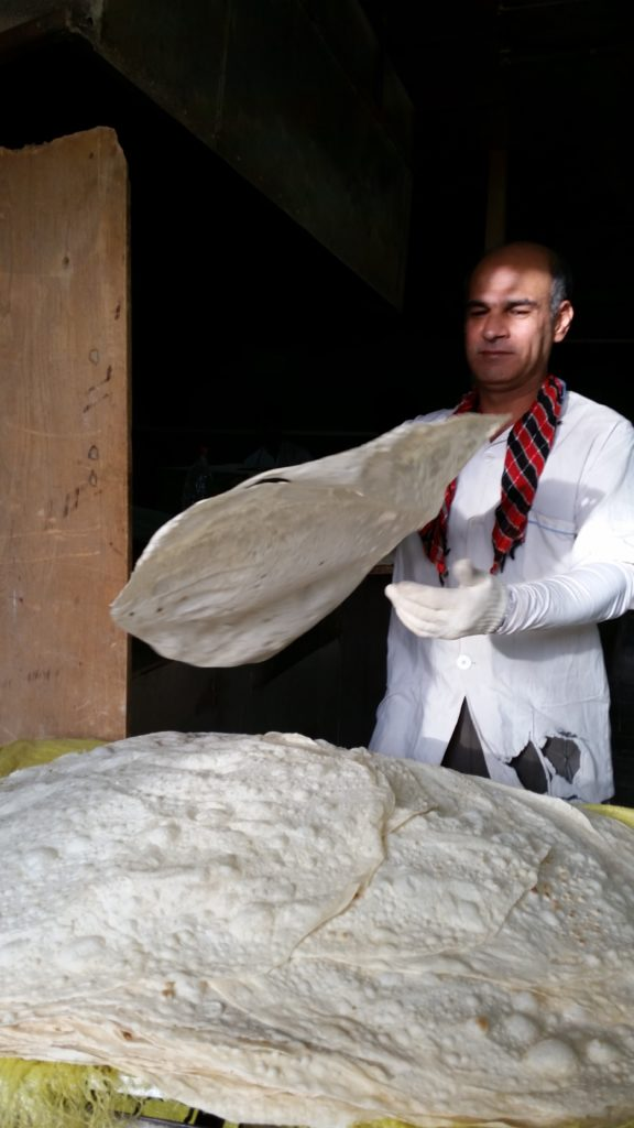 Baker with his wafer thin bread, Qazvin.
