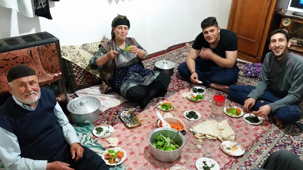 Sharing a meal in a village, Gilan Province.